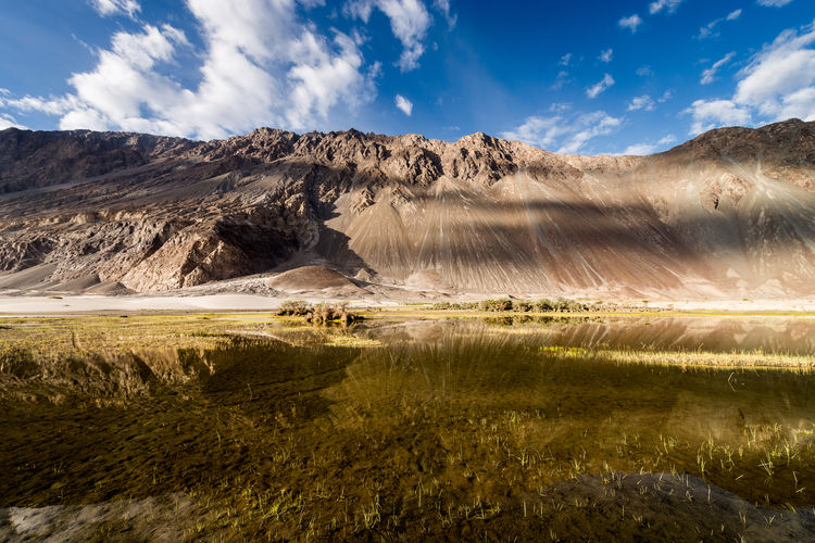 Idyllic shot of rocky mountains reflection in lake at nubra valley
