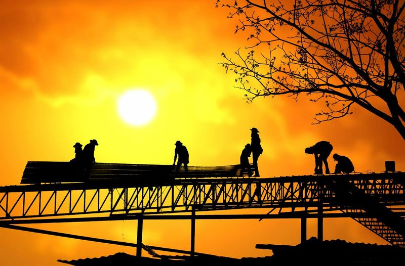 Silhouette People On Bridge Against Sky During Sunset