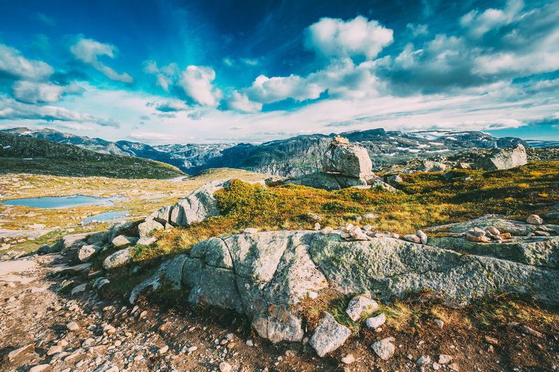 Landscape Of Norwegian Mountains. Nature Of Norway. Travel And Hiking. Amazing Scenic View At Sunny Summer Day. Nobody. Scandinavia. Blue Sky Mountain Landscape Nature Idyllic Day Sky Clouds Travel Norwegian Norway Sunny Summer Scandinavia Blue Yellow Rock Valley Stone