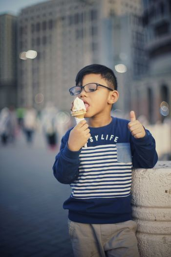 Enjoy ... Boy Ice Cream Good Tasty Delicious Enjoying Life Portrait Medina Bokeh 5 Years Old EyeEm Best Shots EyeEm One Person People Front View City Life City Outdoors Eating Enjoyment Holding Eyeglasses  Lifestyles Day Stories From The City Summer Exploratorium