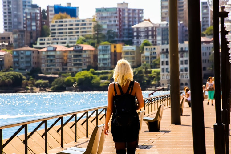 Rear view of woman looking at city view