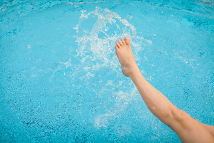 barefoot Blue Body Part Day Human Body Part Human Foot Human Leg Human Limb Lifestyles One Person Pool Swimming Swimming Pool Water