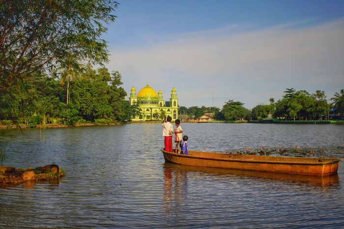 Beauty In Nature Summer Outdoor Freshness Floating On Water Cloud - Sky Transportation Landscape Travel Destinations Outdoors Day Nature Lake Water Vacations Horizon Over Water Childhood People Boat Daylight Calm Waterscape Colors Islam Mosque Live For The Story Place Of Heart Lost In The Landscape