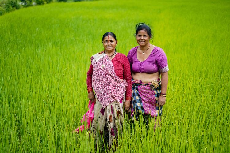Portrait of smiling women standing on farm