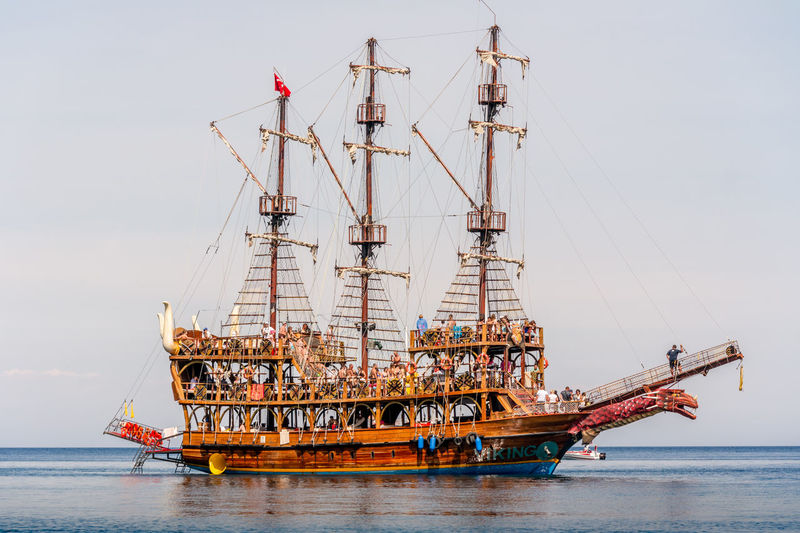 Holiday makers and party goers sightseeing and having fun on a large reproduction pirate ship. Architecture Crane - Construction Machinery Day Horizon Over Water Industry Machinery Mode Of Transportation Nature Nautical Vessel No People Outdoors Sailboat Sea Ship Sky Transportation Travel Water Waterfront