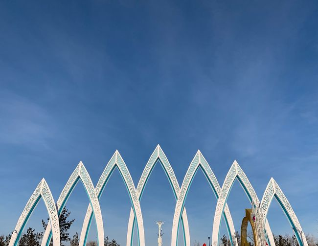 Zhetisu park Winter Astana City Kazakhstan Astana Zhetisu Park Sky Low Angle View Nature Blue Architecture Arts Culture And Entertainment Built Structure In A Row Shape Amusement Park No People Outdoors Cloud - Sky Decoration Creativity Pattern Day Copy Space Design