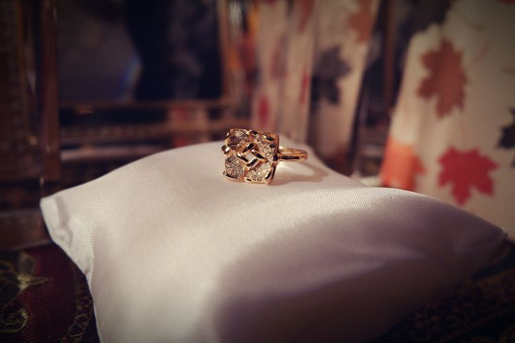 Close-up of wedding ring on pillow