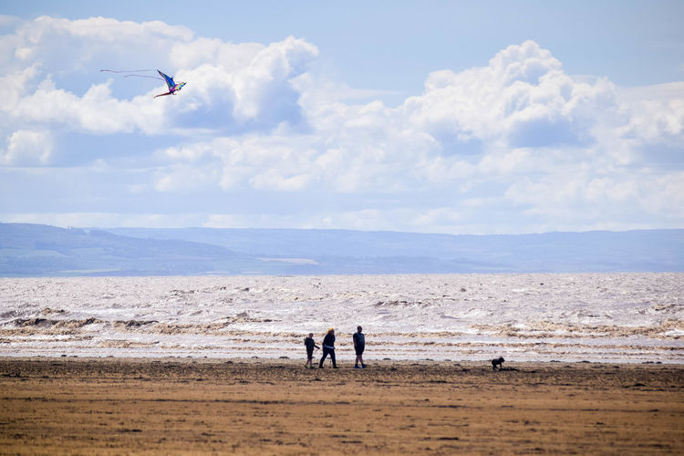 Sky Land Sea Beach Nature Water Beauty In Nature Scenics - Nature Sand Outdoors Beach Photography Horizon Over Water Landscape Beachscape Leading Lines Blue Sky Cloud - Sky Vertebrate Day Horizon Real People Flying People Flying A Kite On The Beach Kite Family On The Beach