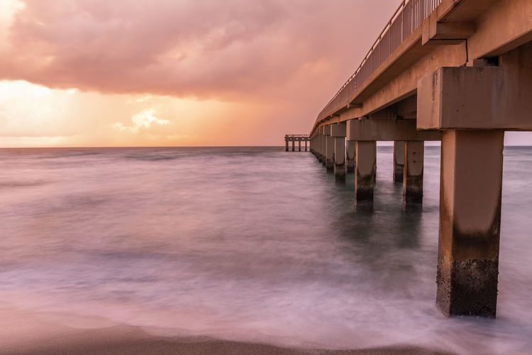 Architectural Column Architecture Beach Beauty In Nature Built Structure Cloud - Sky Dusk Horizon Horizon Over Water Nature No People Outdoors Pier Scenics - Nature Sea Sky Sunset Tranquil Scene Tranquility Water Wood - Material Wooden Post