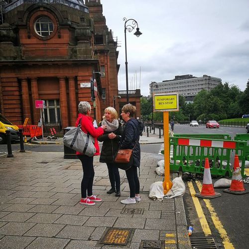 Architecture Real People Built Structure Full Length Adult Outdoors Day People Building Exterior Adults Only Standing Road Sign Men Sky P10 Plus Photography Bus Stop, Candid Photography Streets Of Glasgow Chatting Strangers