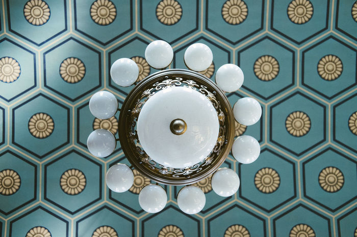 Directly below shot of chandelier on ceiling