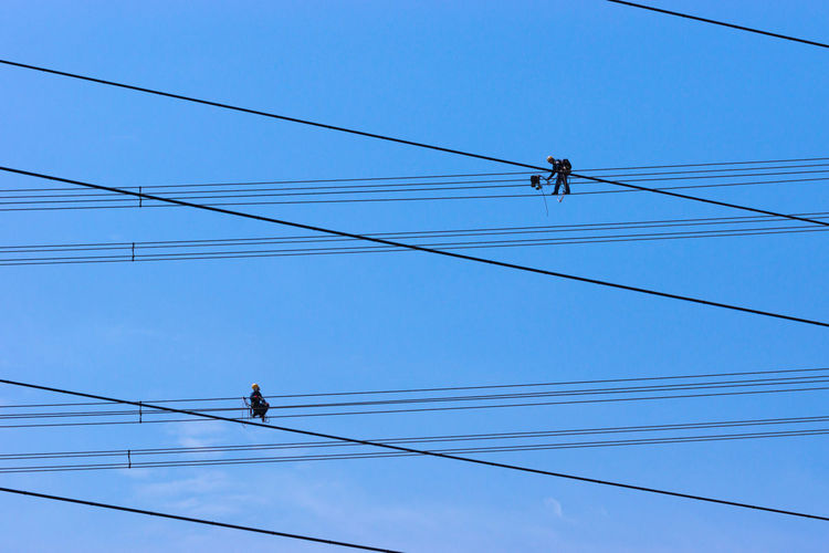 Blue Cable Clear Sky Connection Day Electricity  Electricity Pylon Low Angle View Nature No People Outdoors Pole Power Cable Power Line  Power Supply Sky Wire