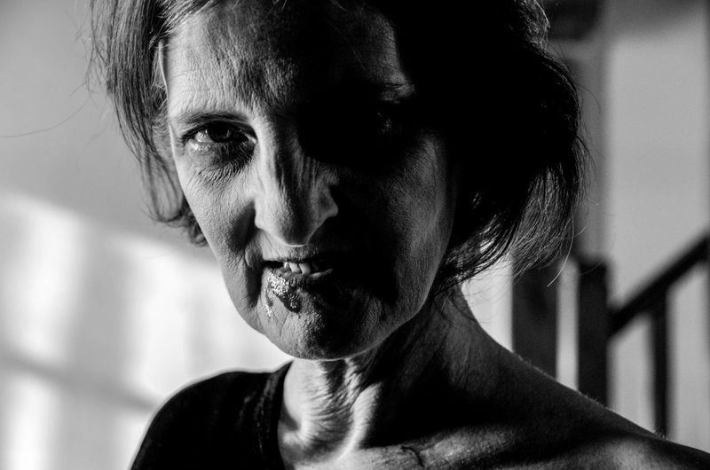 Close-Up Portrait Of Angry Senior Woman
