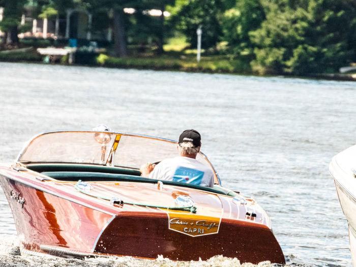 Portrait of man sitting in boat
