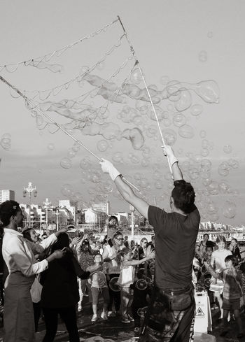 Blowing Bubbles Brighton Brighton Uk Bubble Man Bubbles Against Sky Bubbles Everywhere Bubbles In The Sky Crowds Entertainer Family Fun Happy Happy Crowds Kids Man Attracting Crowds Outdoors Playing With Bubbles Street Performers Street Photography Summer