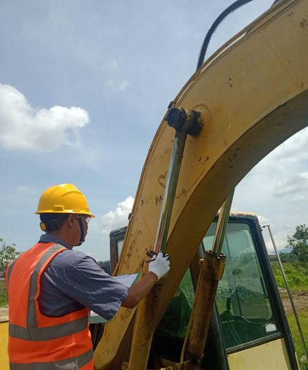 Low angle view of man working against sky