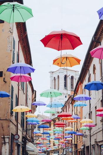 Multi colored umbrellas hanging in row