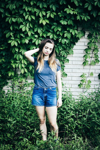 The Portraitist - 2017 EyeEm Awards Green Color Day Outdoors Long Hair Front View Only Women Standing Grass Casual Clothing One Person People Nature Happiness Adult Beauty Summer One Young Woman Only Beautiful People Nature Girls Adult One Woman Only Leaf Plant