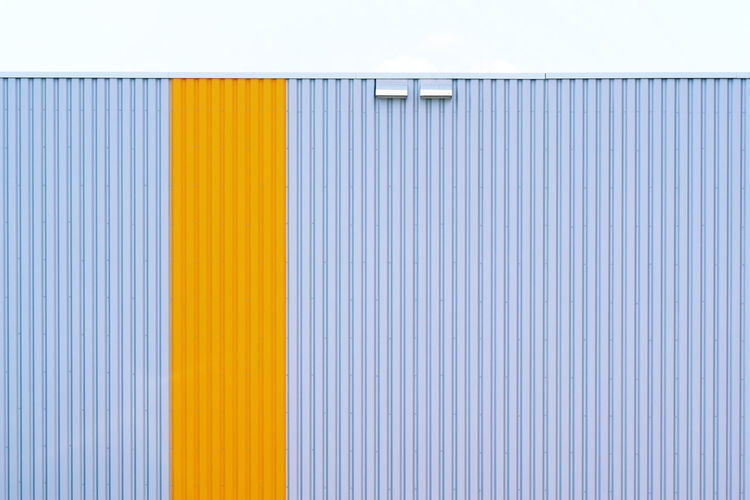 Close-up of yellow wall of building