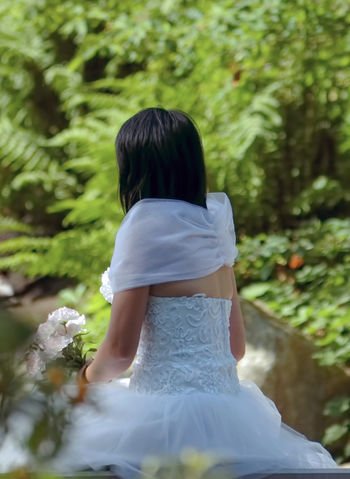 The bride in a beautiful white dress waiting for the ceremony. Fashion Stories Love Marriage Ceremony Bridal Bouquet Bride Day Elegance Beauty Fashion Photography Flower Full Length Girls Lifestyles Marriage  Newlywed One Person People Real People Wedding Day Wedding Dress Women