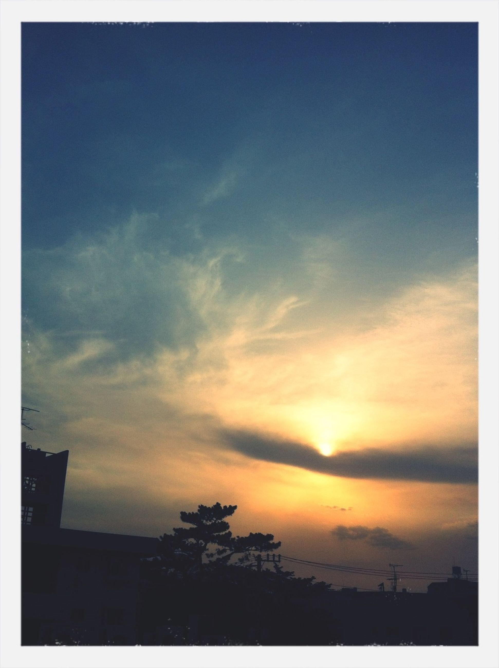 sunset, silhouette, sky, transfer print, orange color, beauty in nature, auto post production filter, low angle view, cloud - sky, scenics, nature, tranquility, tree, tranquil scene, built structure, cloud, building exterior, dusk, architecture, outdoors