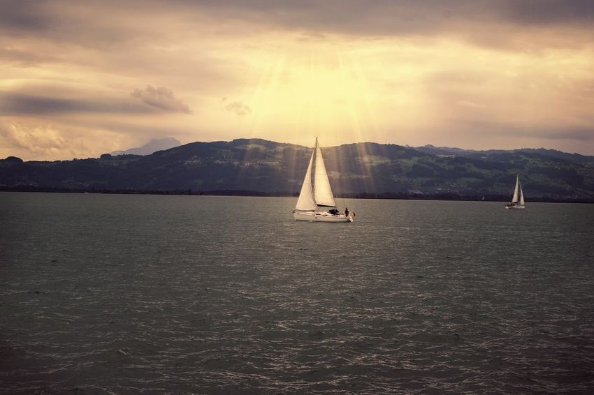 Mountain Dramatic Sky Landscape Sunset Sailboat Sea Outdoors Scenics Tranquility Travel Destinations Cloud - Sky Nautical Vessel Mountain Range Nature Adventure Water No People Day Beauty In Nature Relaxing EyeEm Germany Taking Photos Bodensee Lindau Bodensee