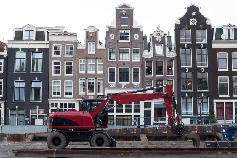 Amsterdam Canal Repairs - A red digger used for canal repair work in Amsterdam Amsterdam UNESCO World Heritage Site Netherlands Holland Under Construction Digger Amsterdam Canal Construction No People Building Exterior Architecture Built Structure Transportation City Mode Of Transportation Building Land Vehicle Day Motor Vehicle Red