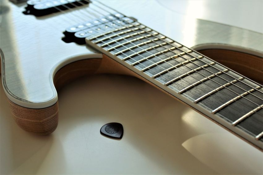 Arts Culture And Entertainment Close-up Day Electric Guitar Fretboard Guitar High Angle View Indoors  Music Musical Instrument Musical Instrument String No People Pick Plectrum Technology Woodwind Instrument