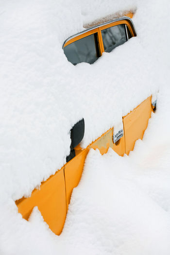 Close-Up Of Snow Covered Vehicle