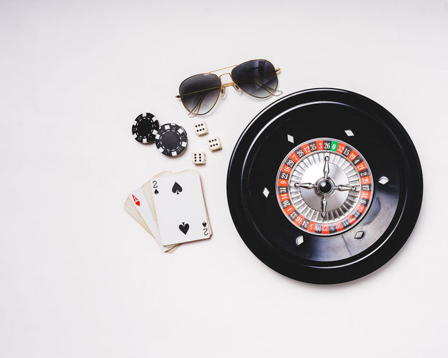 Roulette table top view. Roulette Wheel Cards Play Cards Poker Chips Top View Poker Night Gambling Playing Pokerface Bad Luck Luck PokerGame Roulette Wheel Roulette Table Roulette Play Clock Face Minute Hand Time Clock White Background Close-up