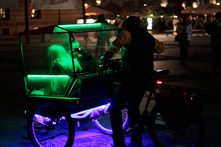 a couple using a rikshaw as a taxi whilst visiting Berlin Bikers Blurred Motion City Life Couples❤❤❤ Drivers Ed Enjoyment Festival Of Lights Funny Faces Illuminated Lifestyle Lifestyles Lighting Equipment Motion Capture Night Real People Rikscha Rikshaw Street Taxis Tourisme