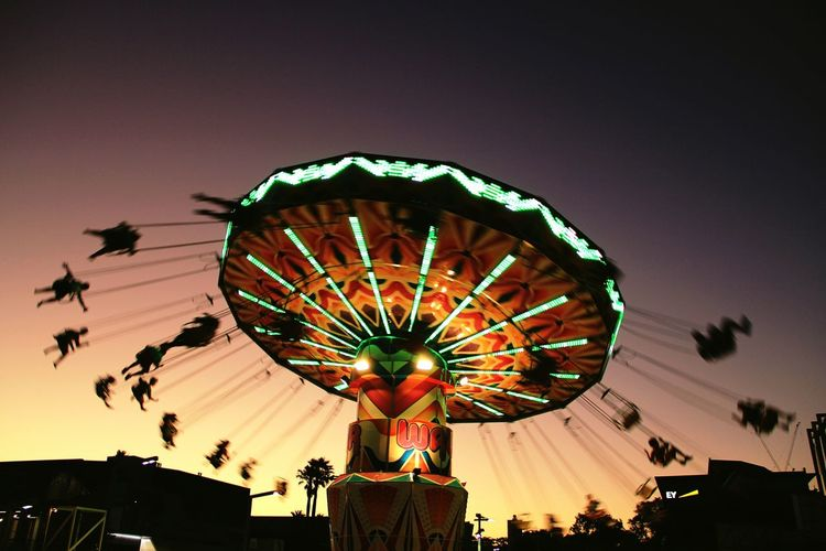 Wave Swinger into the Sunset at Fringe Festival on Elisabeth Quay, Perth | Fun Australia Colours Of Summer Light And Shadow Silhouette Sunset Silhouettes People Photography Photography In Motion Cities At Night Feel The Journey Flying Fair Fairground An Eye For Travel