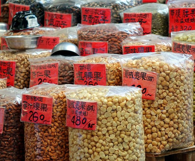 A vendor sells a variety of nuts at the Zhingjie dry goods market in Kaohsiung, Taiwan Almonds Cashews Dry Food Market Dry Goods Food Macadamia Nuts Market Stall Nuts Roasted Nuts Sack Taiwan