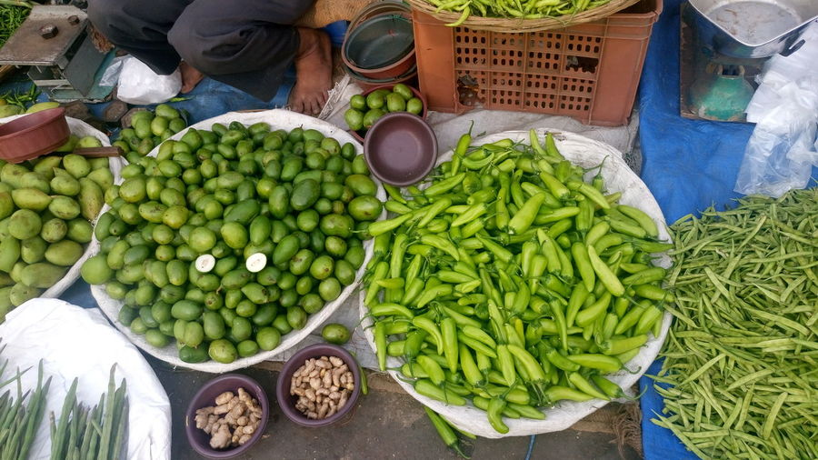 Vegetable market Abundance Agriculture Basket Choice Food Food And Drink For Sale Freshness Fruit Green Color Healthy Eating High Angle View Market Market Stall Men Retail  Variation Vegetable Vegetable Market