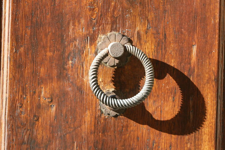 Close-Up Of Door Handle On Wooden Surface