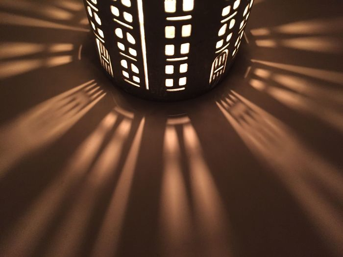 Close-up of illuminated lamp on table