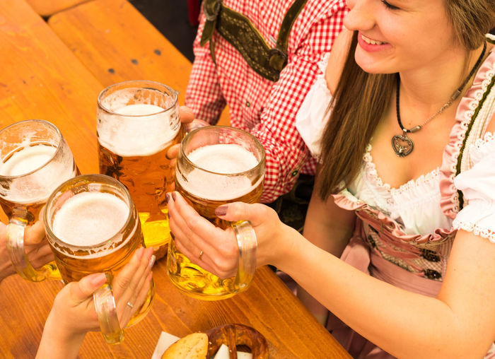 Friends Toasting Beer Glasses At Restaurant