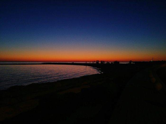 Scenics Sunrise Beauty In Nature Sky Beach No People Nature Travel Destinations Landscape Outdoors Silhouette Horizon Over Water Water Night Clear Sky