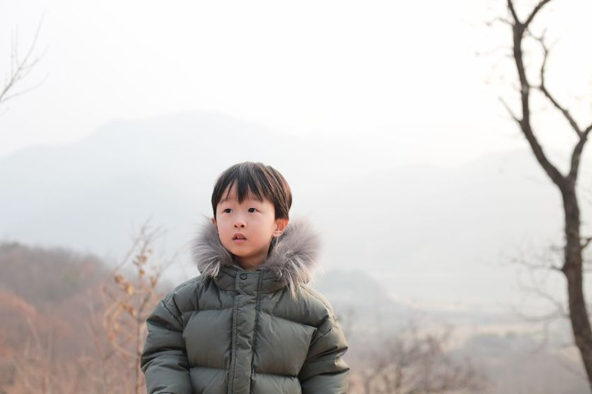 EyeEm Nature Lover EyeEmNewHere Fashion Hello World Taking Photos Tree Winter Beauty In Nature Boy Casual Clothing Childhood Headshot Human Body Part Kid Leisure Activity Lifestyles Looking At Camera Mountain Nature One Person Outdoors People Portrait Real People Warm Clothing