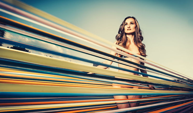 Model standing amidst of colorful ribbons, fashion setting Beautiful Fashion Free Freedom Perspective Ribbon Stripes Beautiful Woman Beauty Beautyful  Color Colorful Fashion Model Fashion Photography Hair Hairstyle Long Hair Low-angle Shot Model Women Young Women