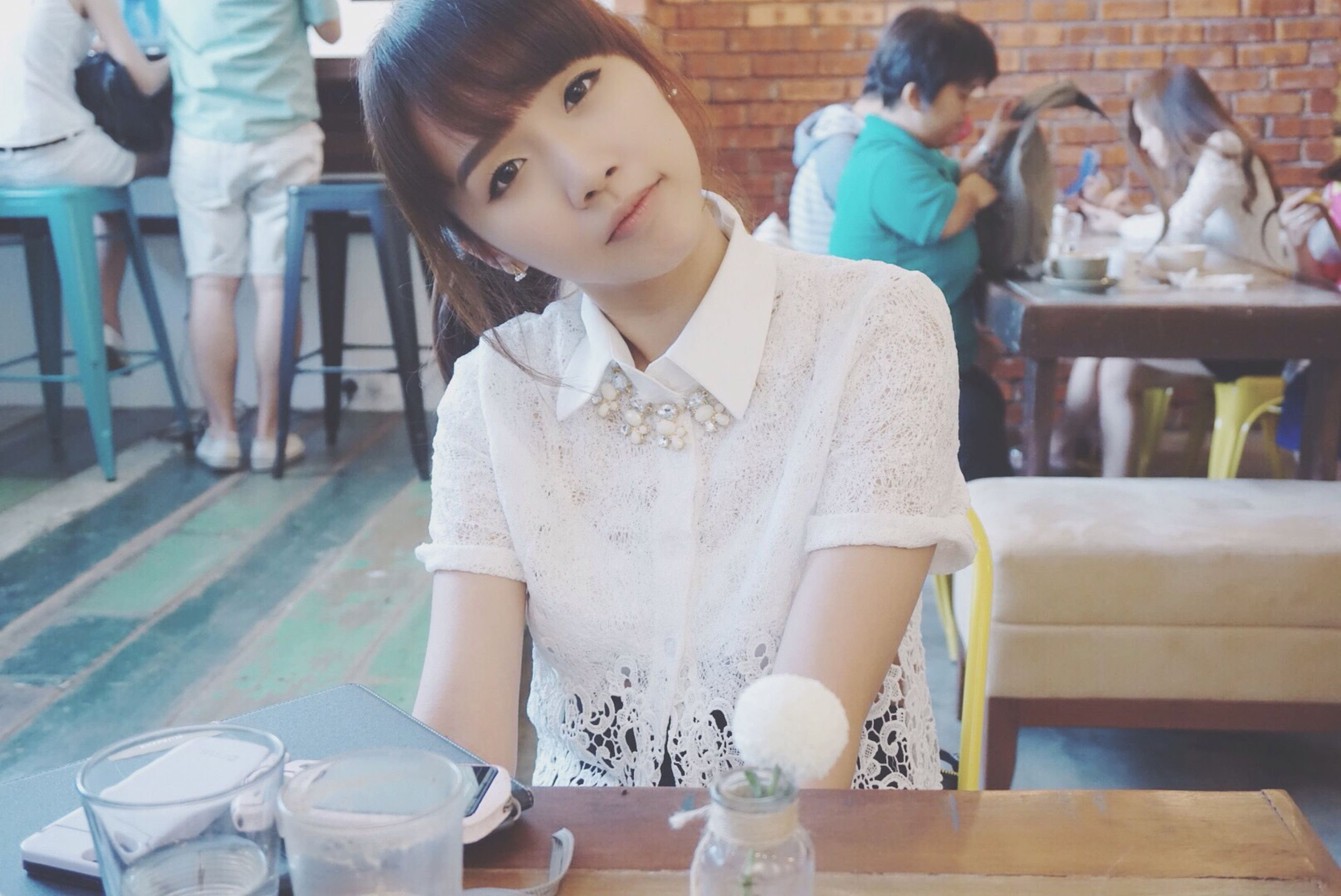 casual clothing, lifestyles, indoors, leisure activity, person, sitting, childhood, standing, boys, table, front view, holding, chair, incidental people, food and drink, elementary age, full length, three quarter length