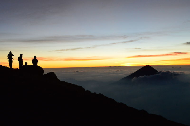 Guatemala Acatenango Beauty In Nature Clouds Landscape Mornig Nature Outdoors Real People Scenics Sea Of Cloud Silhouette Sky Sunrise Tranquil Scene Tranquility Vulcano Vulcano Aqua The Great Outdoors - 2018 EyeEm Awards The Traveler - 2018 EyeEm Awards