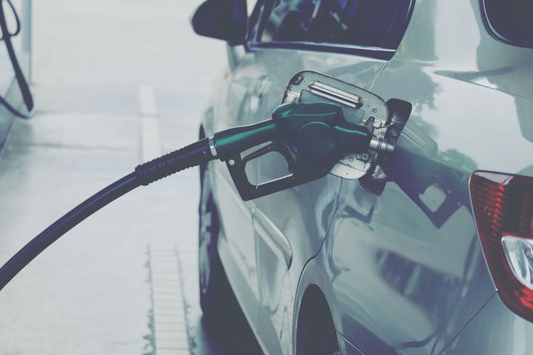 Close-up of car refueling at gas station