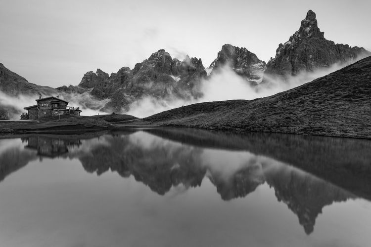 Scenic view of lake and mountains against sky in dolomites mountains
