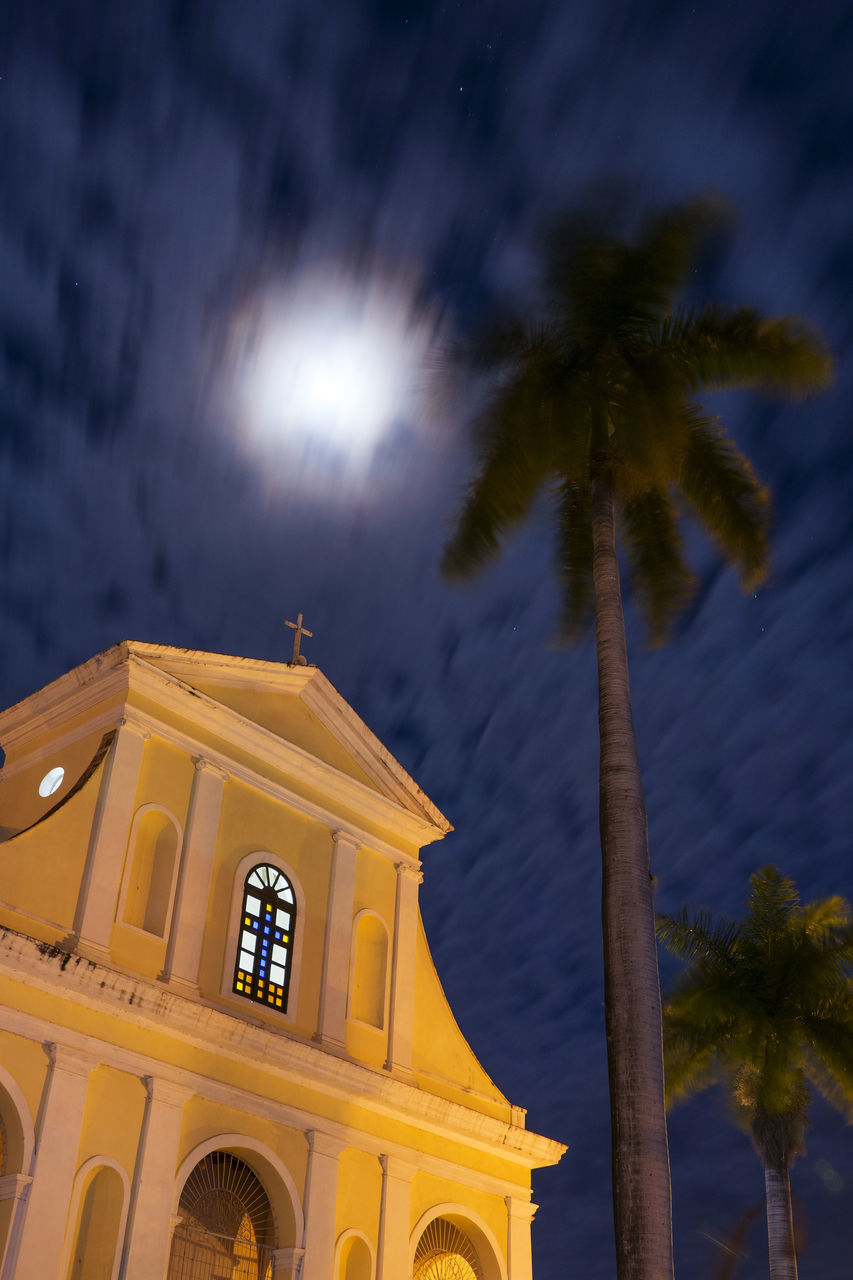 low angle view, palm tree, architecture, built structure, tree, sky, no people, religion, outdoors, cloud - sky, place of worship, building exterior, day, nature