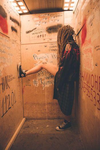 All yours is underground. Photo taken in a elevator of tenement house in SPb Saint Petersburg Cityview Female Dreads Underground Streetphotography Standing City Graffiti Vandalism Street Art Spray Paint Hip Hop