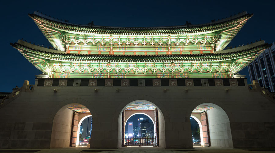 Low angle night shot of the illuminated Gwanghwamun Gate. Landmarks of Seoul in South Korea Ancient Architecture ASIA City Cultures Fortress Gate Gateway Gwanghwamun History Horizontal Landmark Night No People Nobody Oriental Outdoors Palace Seoul Sigth South Korea Travel