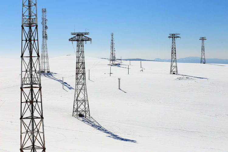Electricity Pylons In Winter