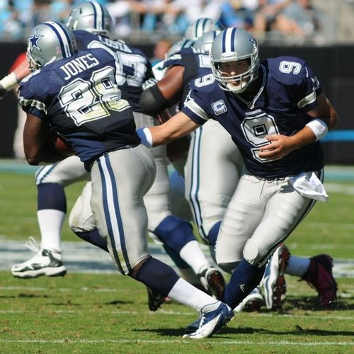Getting ready for the 2013 Football Season. NFL Quarterback Tony Romo hands off to teammate Dallas Cowboys