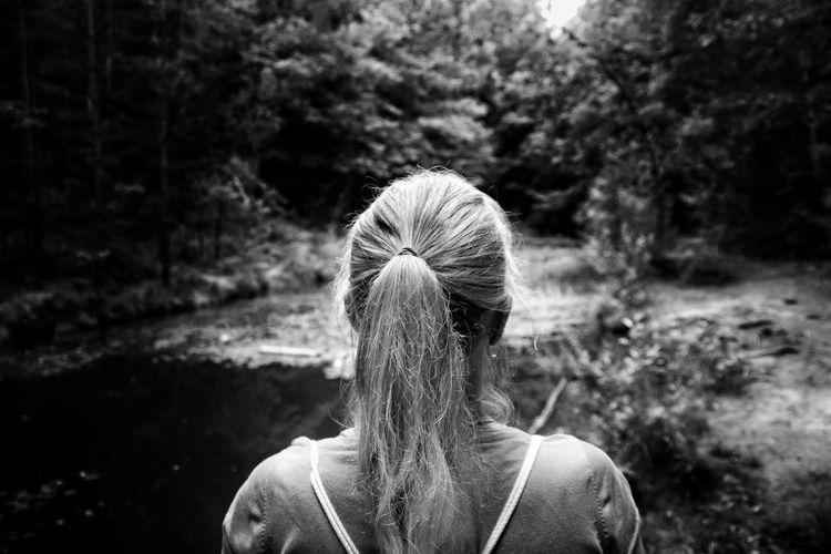 Rear view of woman looking at forest